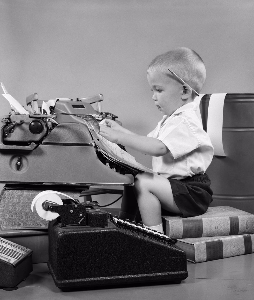 Stock Photo: 4186-4233 1950S Child Typing Sitting At Typewriter