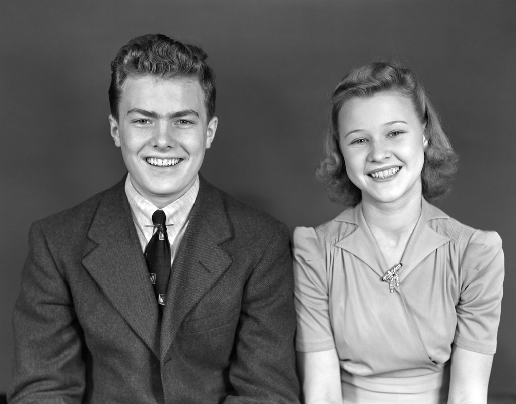 Stock Photo: 4186-4304 1940S Waist Up Portrait Smiling Young Teen Couple Boy Girl