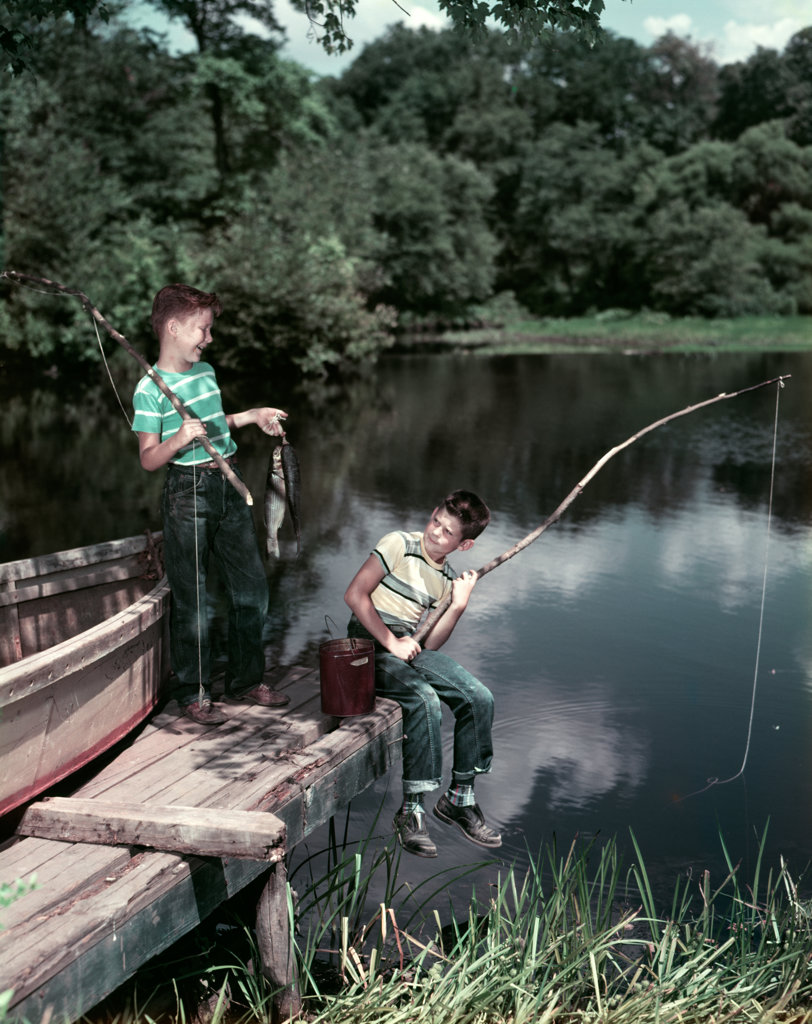 1950S Two Boys Fishing In Lake From Dock Outdoor  : Stock Photo