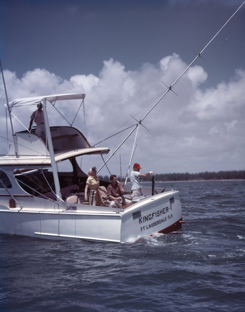 Stock Photo: 4186-4454 1950S White Charter Fishing Boat 3 Men 1 Woman Ft Lauderdale Florida Sport Fishing Vacation