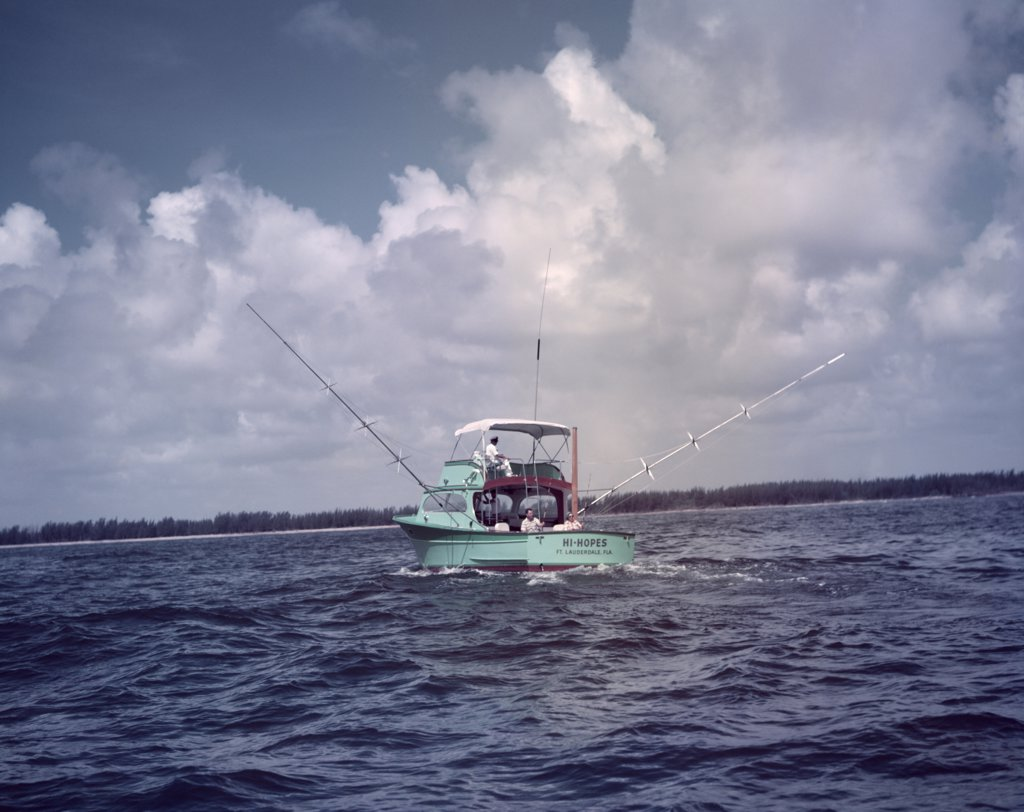 Stock Photo: 4186-4466 1950S Turquoise Charter Fishing Boat On Water Florida Sport Fishing Trawler