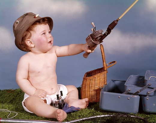 Stock Photo: 4186-5073 Baby With Fishing Hat And Gear Holding Fishing Rod Studio Tackle Box Creel Basket