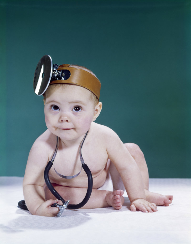 1960S Baby Making Funny Face Wearing Medical Doctor Opthalmoscope And Stethoscope : Stock Photo