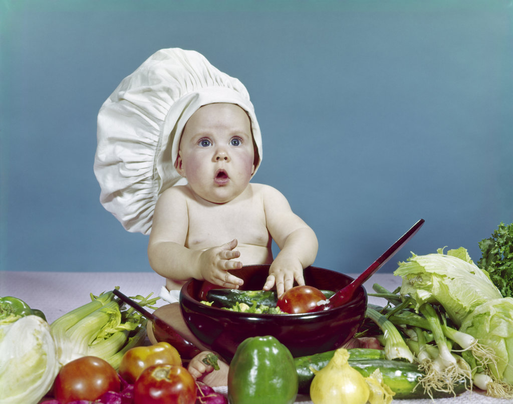 1960S Baby Wearing Chef Hat About To Toss Salad With Hands Wooden Salad   : Stock Photo