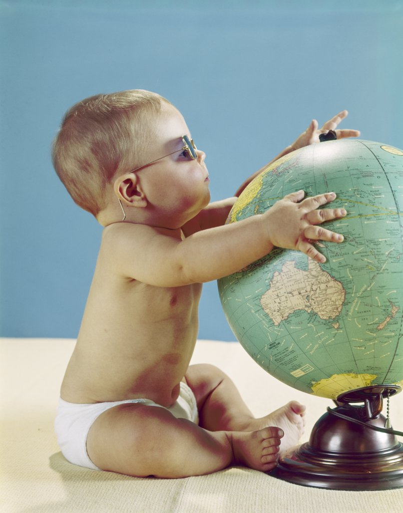Stock Photo: 4186-5259 1960S Baby Wearing Eyeglasses Hugging The World Globe Earth