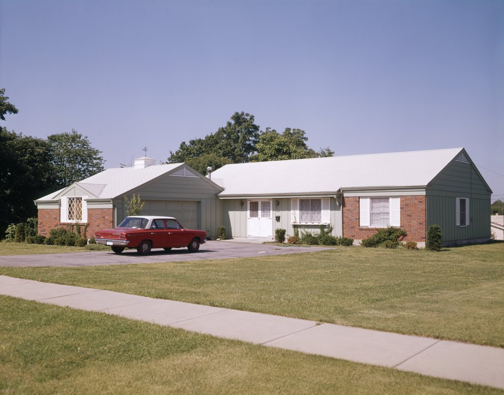 Stock Photo: 4186-5299 1960S Suburban Brick Home With Car Driveway Near Dayton Ohio