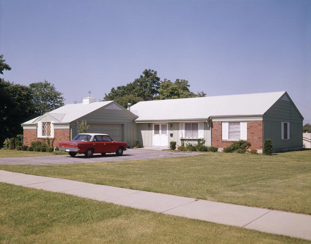 1960S Suburban Brick Home With Car Driveway Near Dayton Ohio : Stock Photo