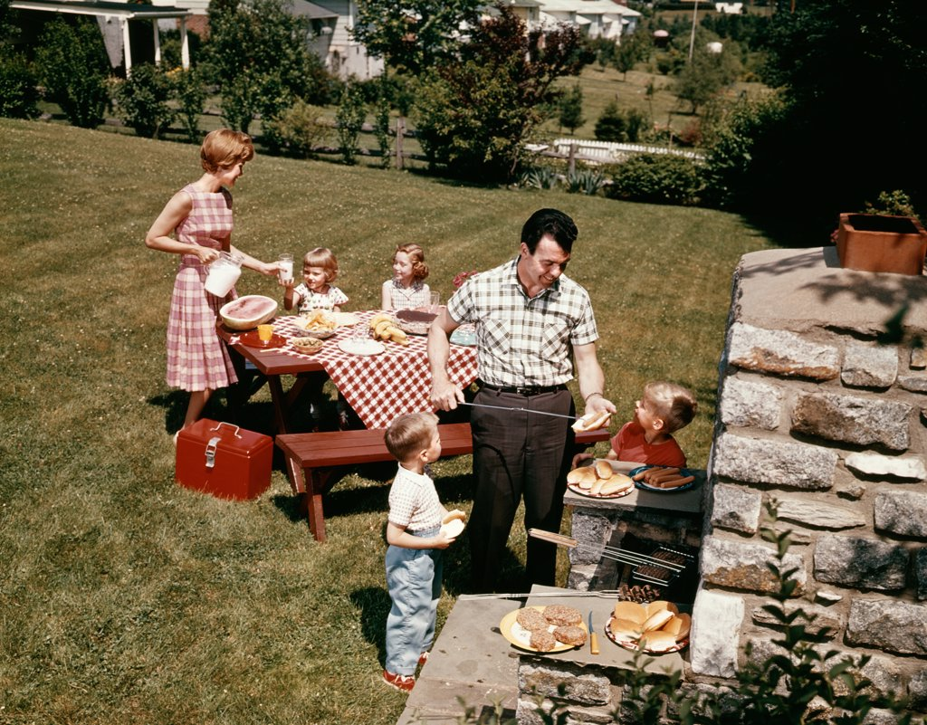 Stock Photo: 4186-5462 1960S Family Father Mother Two Daughters Two Sons Backyard Bar-B-Que Outdoor