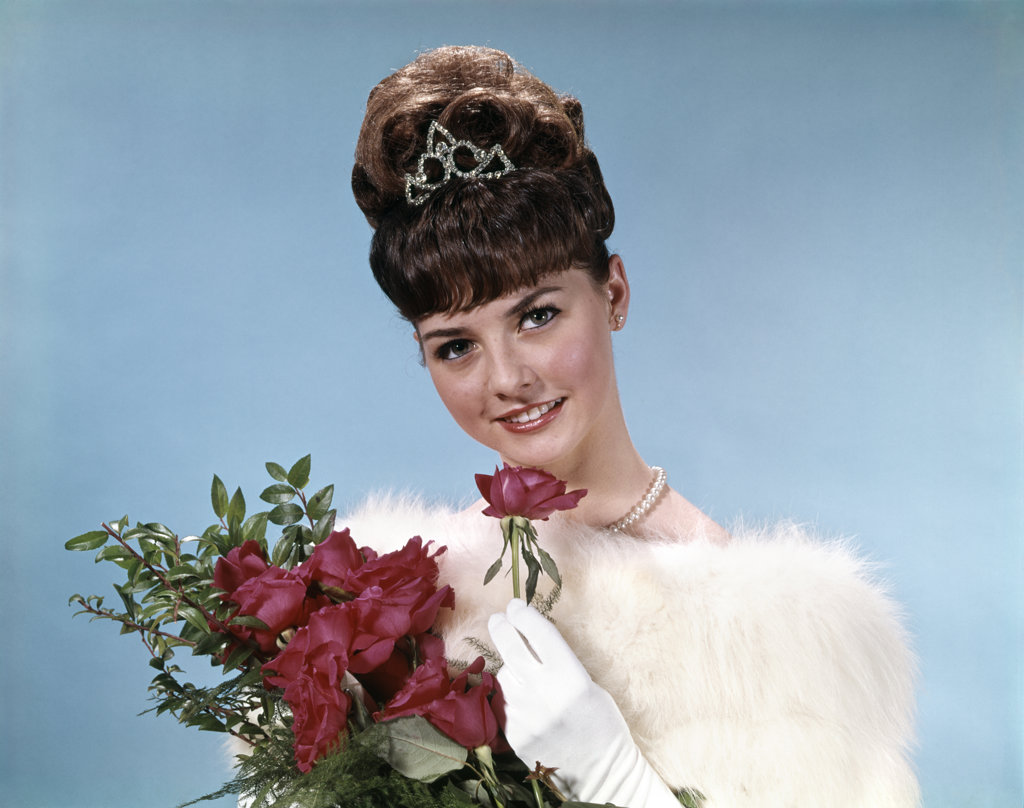 Stock Photo: 4186-6481 1960S Teenage Beauty Queen Holding Red Roses Wearing Fur Stole And Tiara