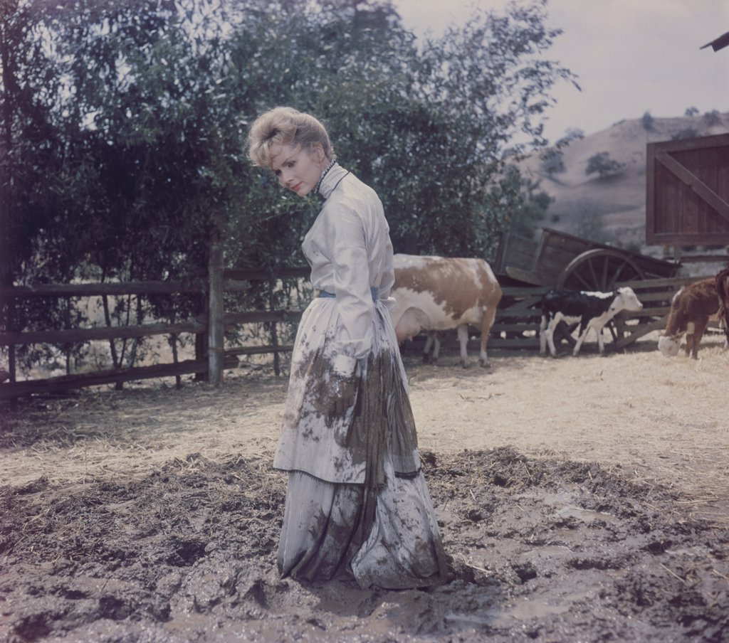 Stock Photo: 4186-670 1960S 1961 The Second Time Around Star Debbie Reynolds Standing In Mud