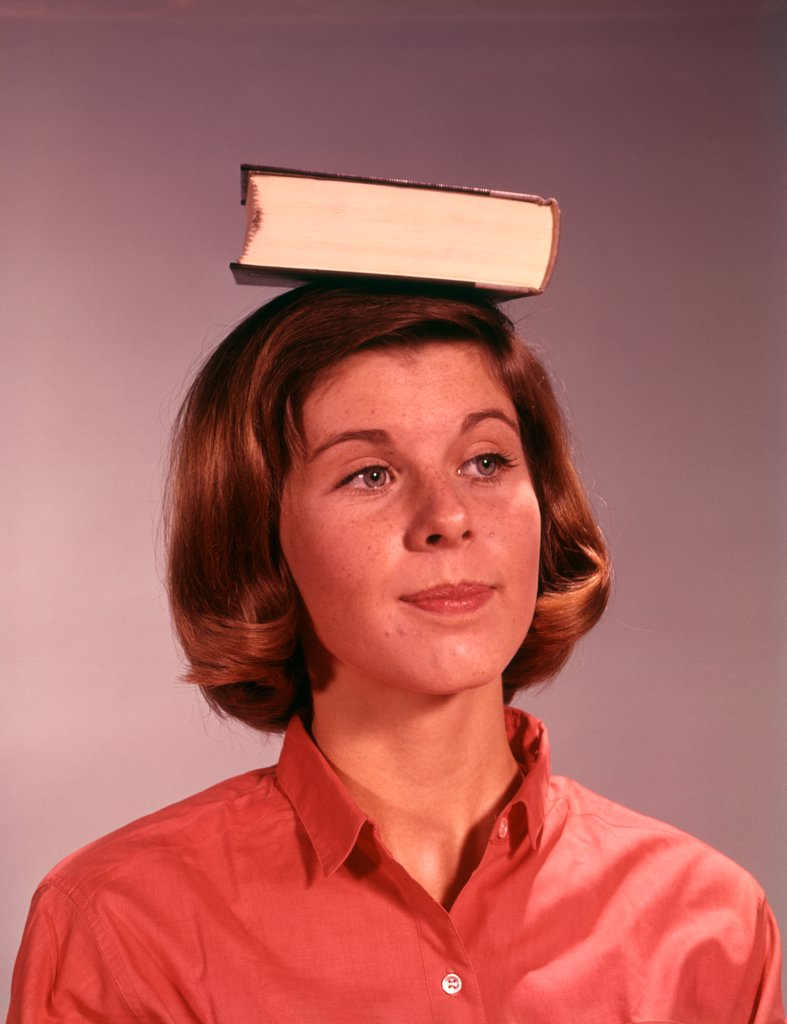 1960S 1970S Young Teenage Girl Woman Balancing Book On Head : Stock Photo