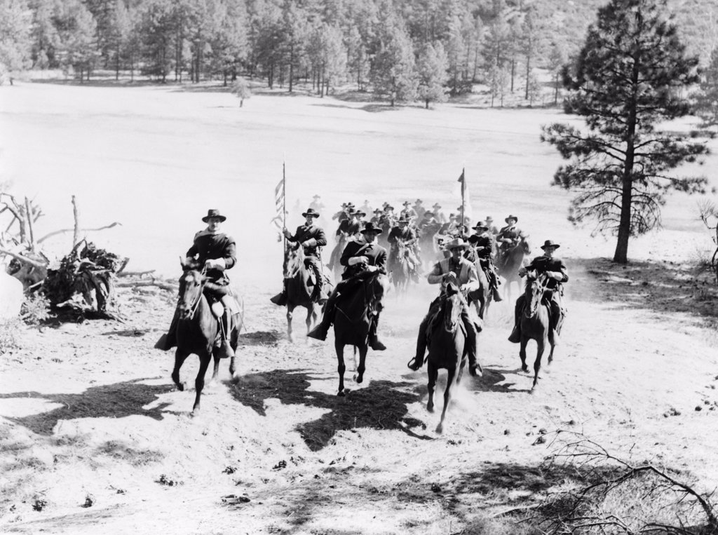 Stock Photo: 4186-683 1880S United States Army Cavalry Troop Riding To The Rescue