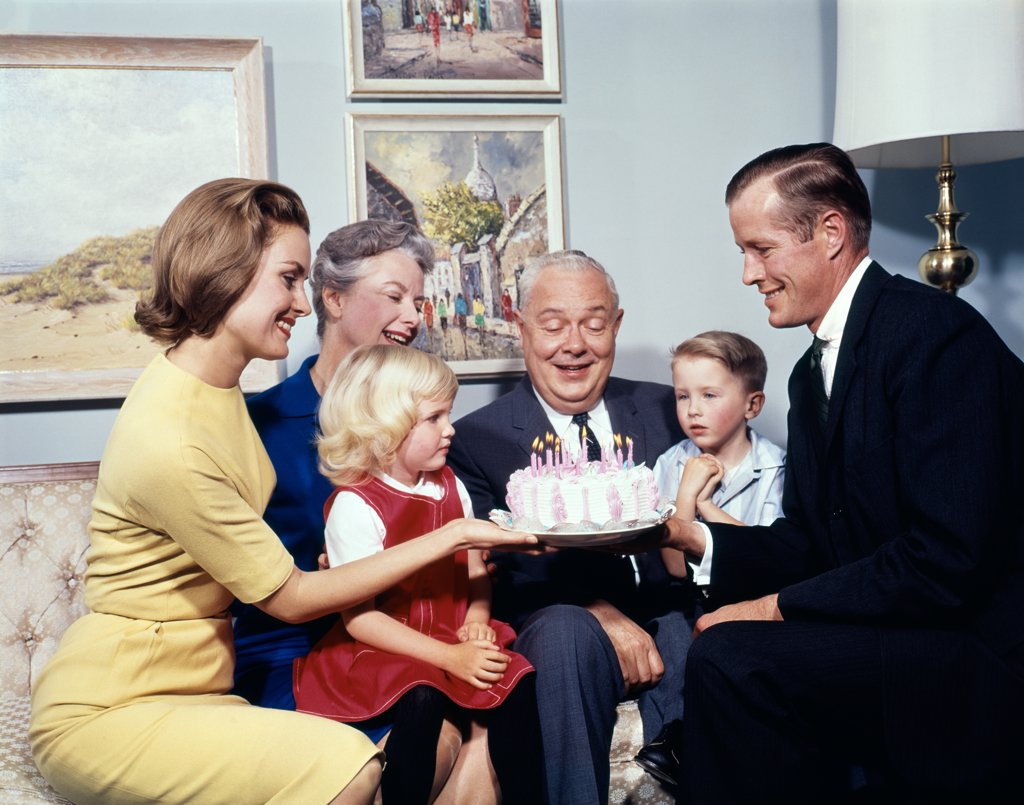 1960S Three Generation Family With Birthday Cake : Stock Photo