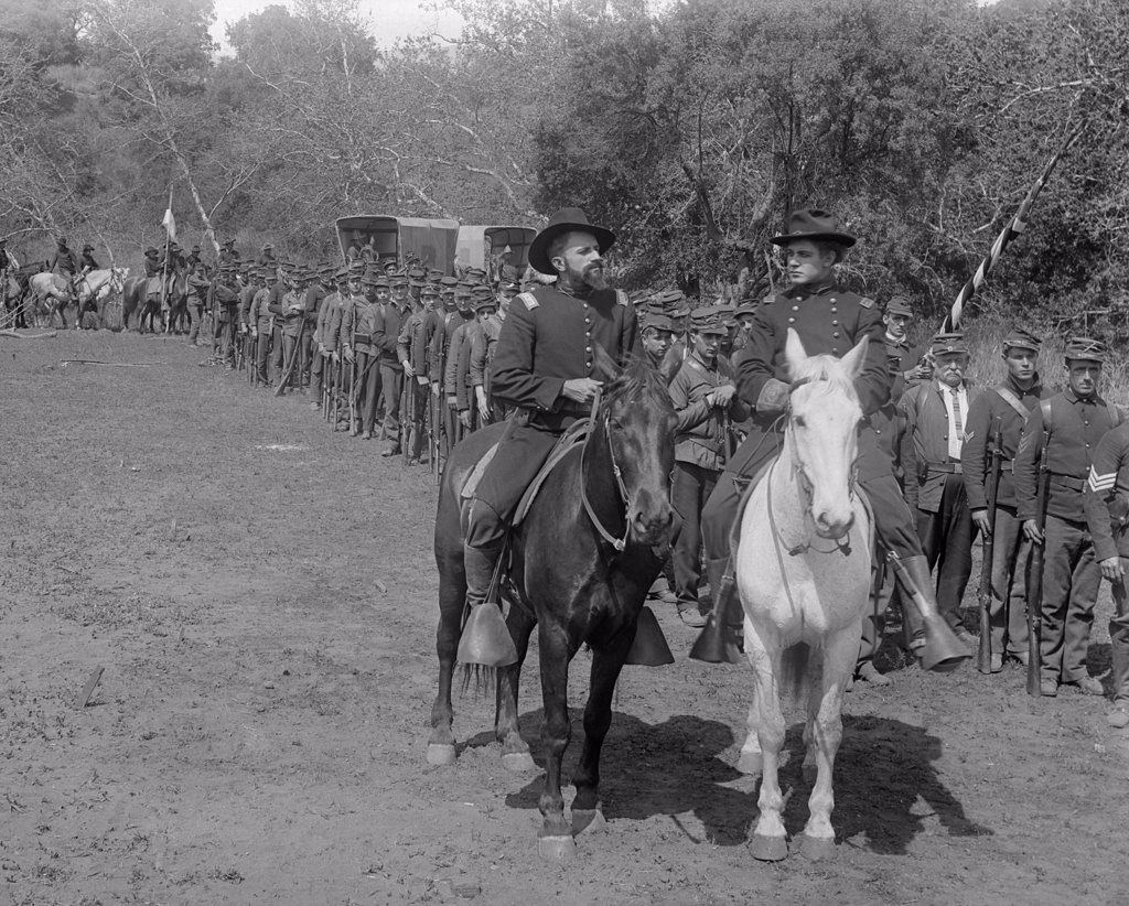 Stock Photo: 4186-810 Mounted Cavalry Officers Beside Line Of Civil War Soldiers Silent Movie Still