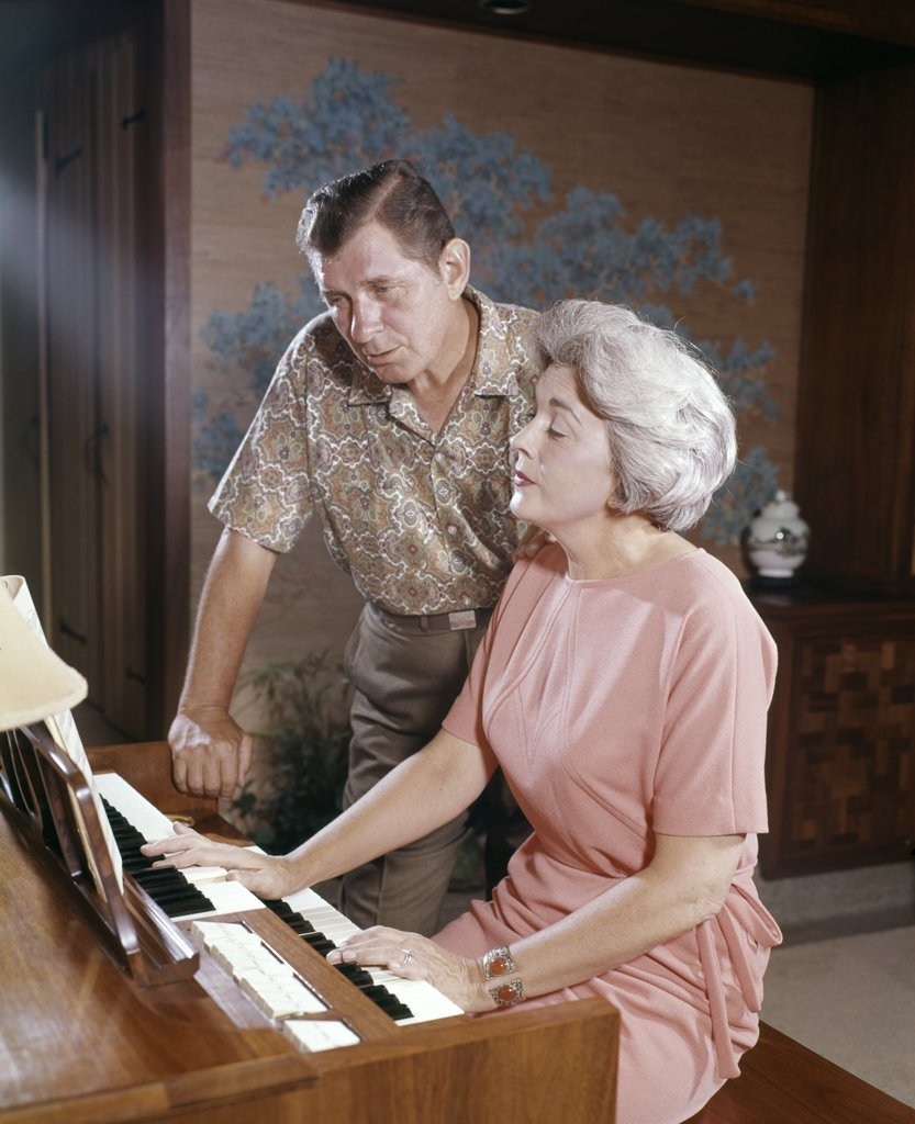 Stock Photo: 4186-8265 1960S Mature Couple Man And Woman Playing And Singing Together At Home Organ Keyboard Instrument