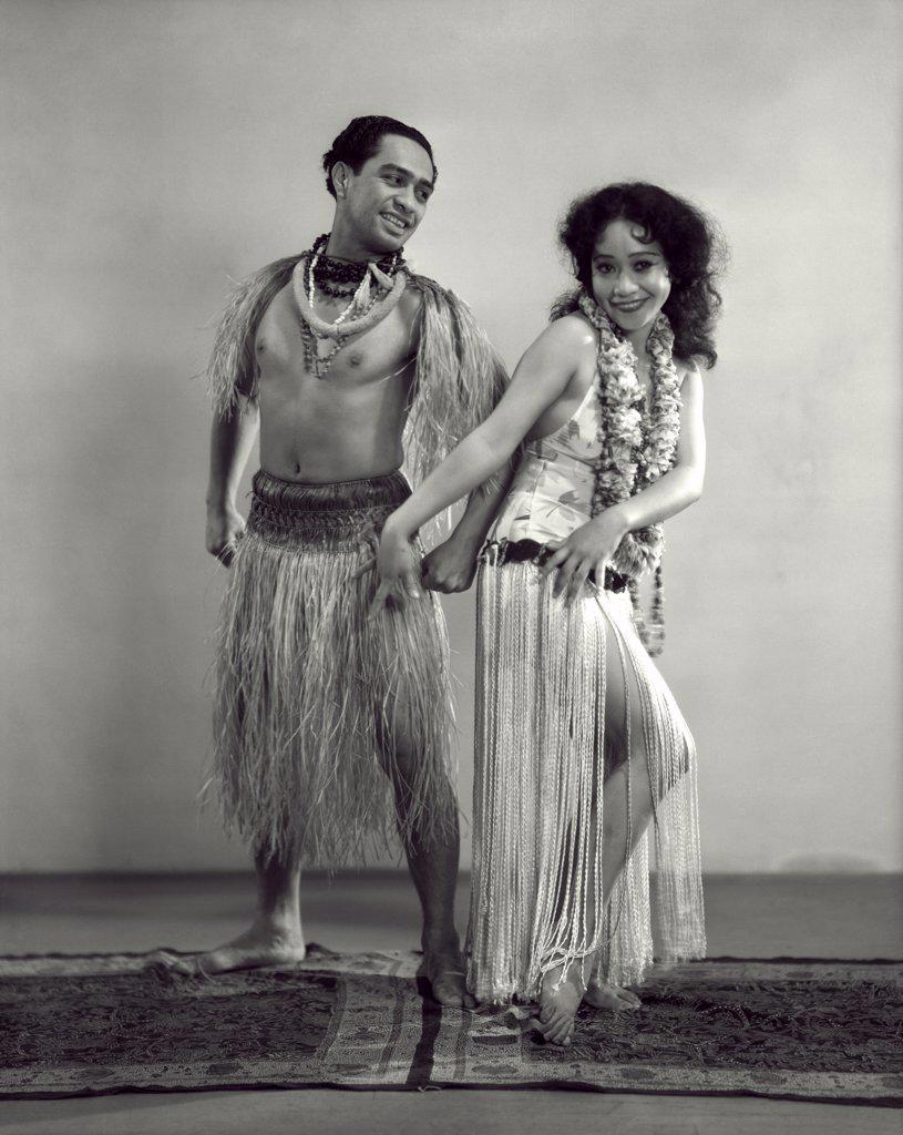 Stock Photo: 4186-832 1920S Studio Shot Man Woman Polynesian Dancers Grass Skirts