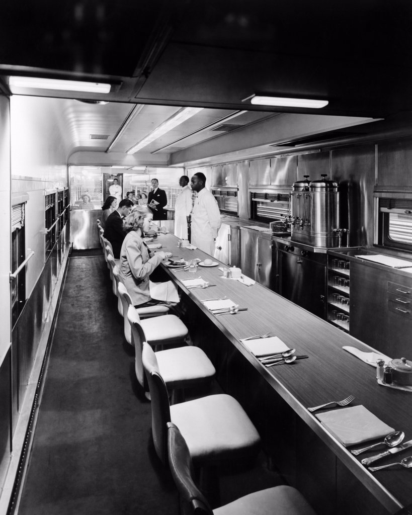 Stock Photo: 4186-853 1930S 1940S 1950S Patrons And Staff Inside Dining Car On Passenger Railroad Train