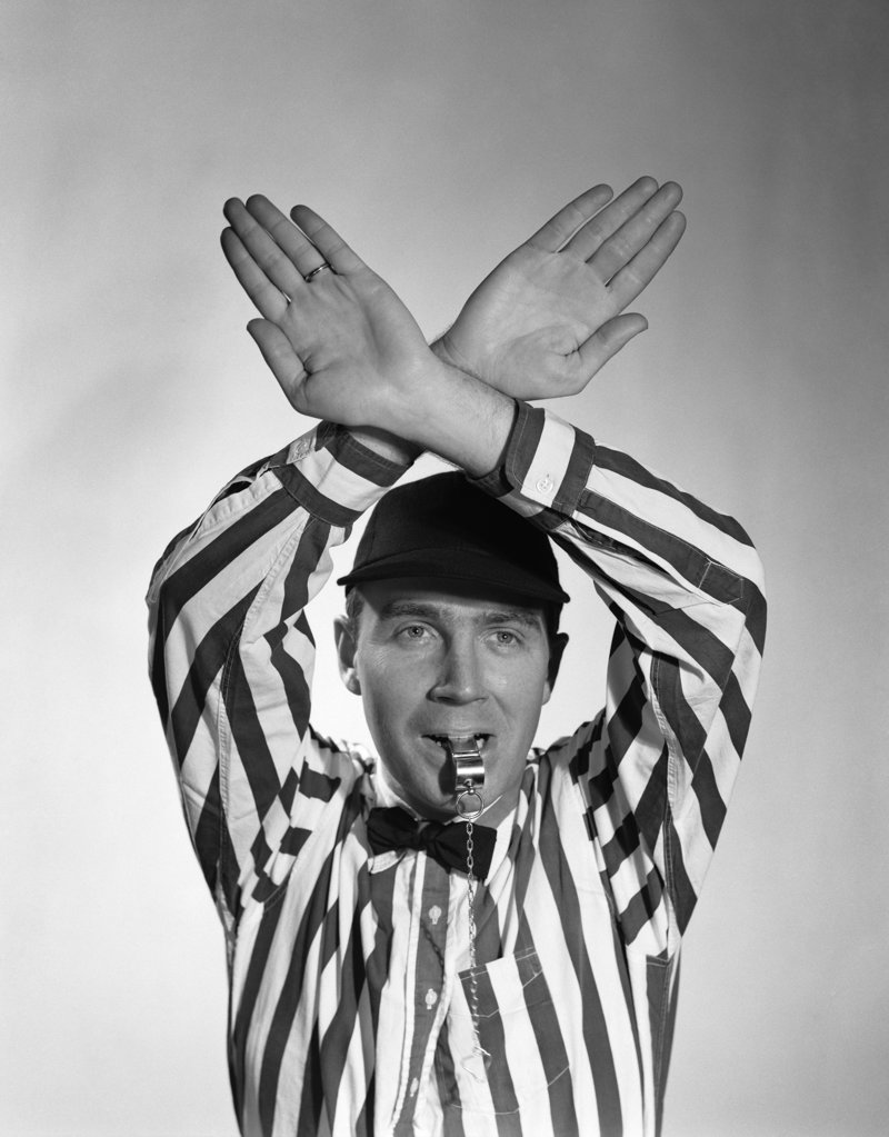 Stock Photo: 4186-902 1950S Football Referee Making Hand Signal Time Out Blowing Whistle