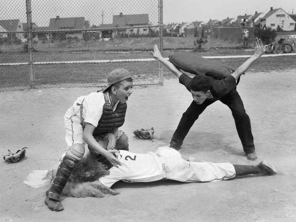 Stock Photo: 4186-933 1950S Youth League Umpire Calling Safe Player Sliding Into Home Plate