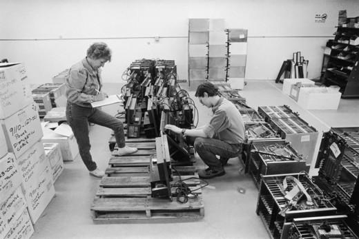 Workers Inventory Telephone Equipment : Stock Photo
