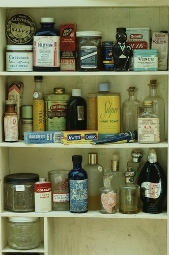 Cupboard of Antique Tonics and Perfumes : Stock Photo