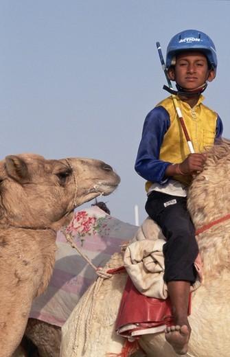 Child Camel Jockey at Races : Stock Photo