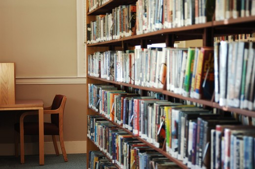 Stock Photo: 4193R-1005 stack of library books and cubicle for reading