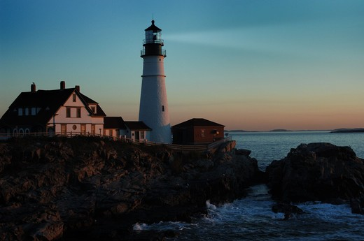 Portland lighthouse shining beacon before dawn : Stock Photo