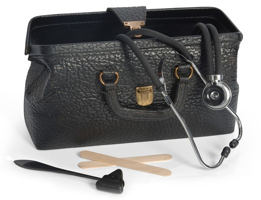 Stock Photo: 4193R-1072 Open vintage medical bag with stethescope, reflex hammer and tongue depressors and clipping path