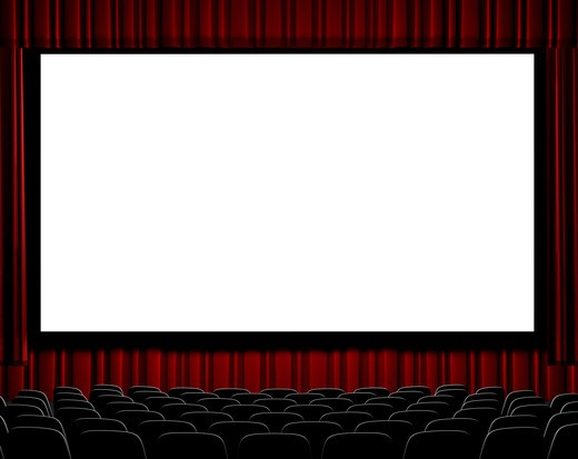 A movie theater showing blank screen from straight on shot. : Stock Photo