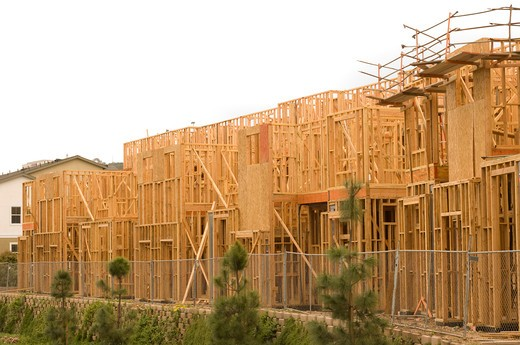 Stock Photo: 4193R-1181 Wood framing of a new housing development with a white sky for copy