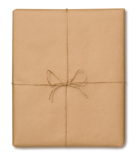 Brown paper package tied with string on a white background with a clipping path : Stock Photo