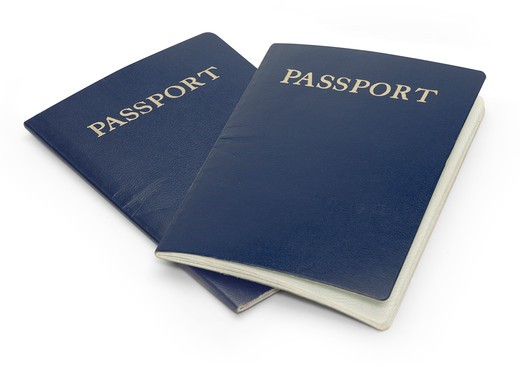 Stock Photo: 4193R-1259 Two passports isolated on a white background with clipping path