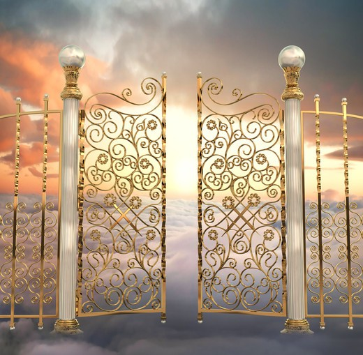 The pearly gates of Heaven being opened : Stock Photo