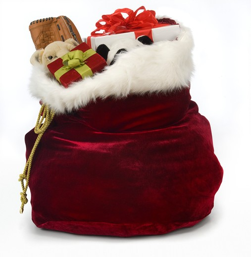 Santa S Bag Of Toys : Santa s sack filled with toys on a white background stock