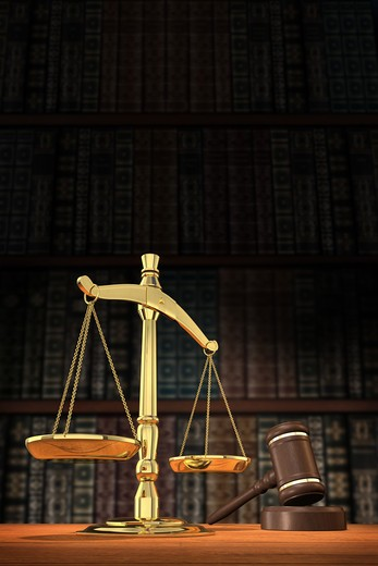 Stock Photo: 4193R-1467 Scales of justice and gavel on desk with dark background that allows for copyspace.