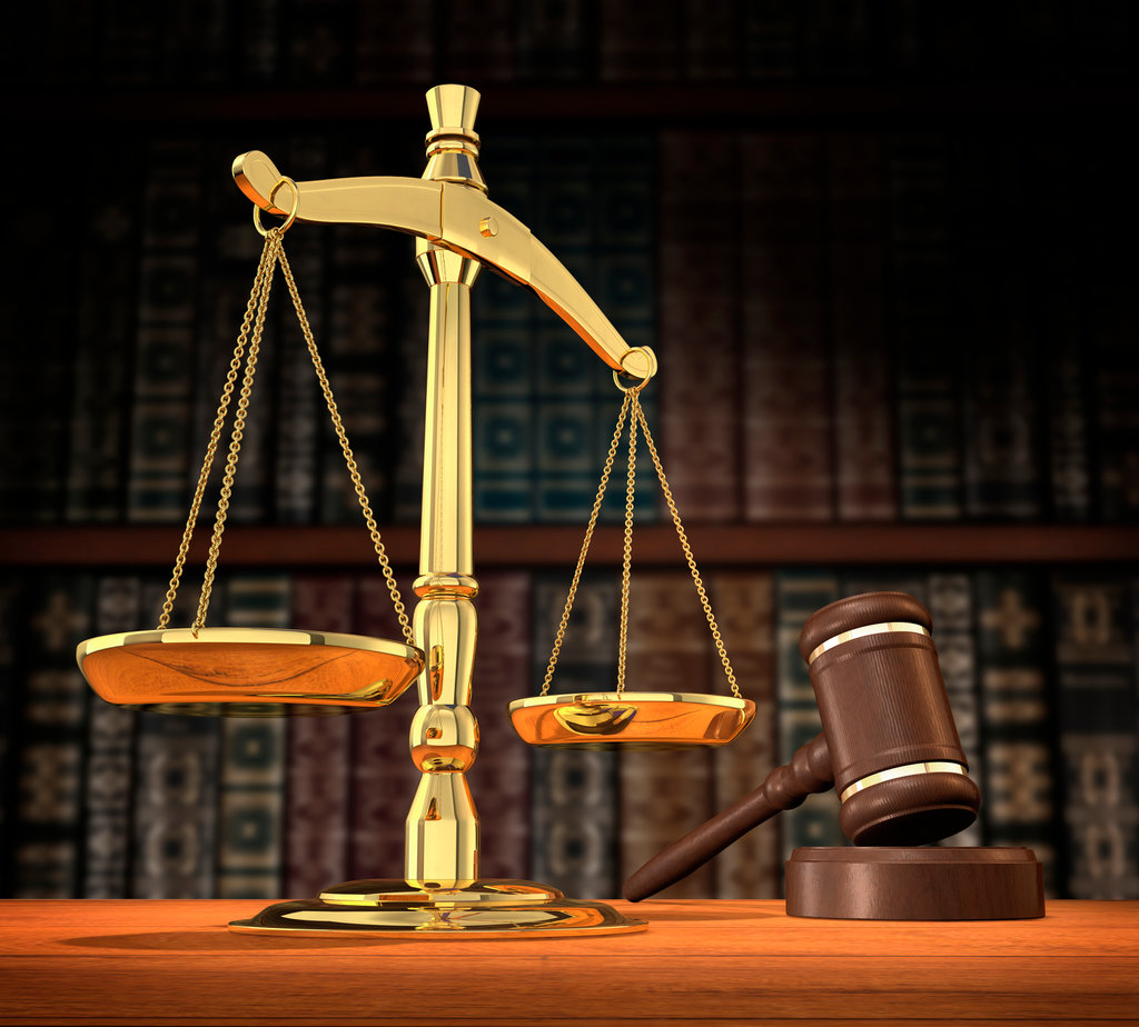 Stock Photo: 4193R-1470 Scales of justice and gavel on desk with dark background that allows for copyspace.