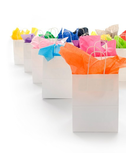 White shopping bags with colorful tissue paper on a white background : Stock Photo