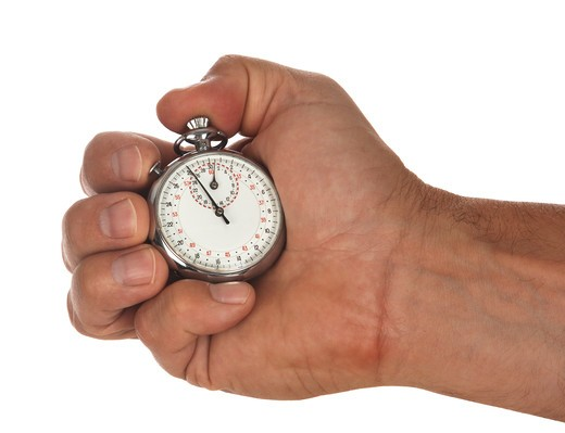 male hand holding stop watch : Stock Photo