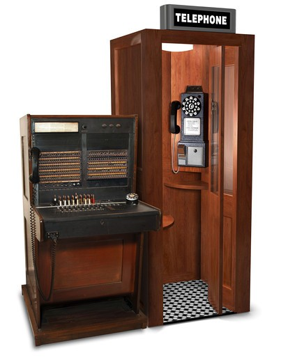 Stock Photo: 4193R-1621 vintage telephone switchboard station and phone booth
