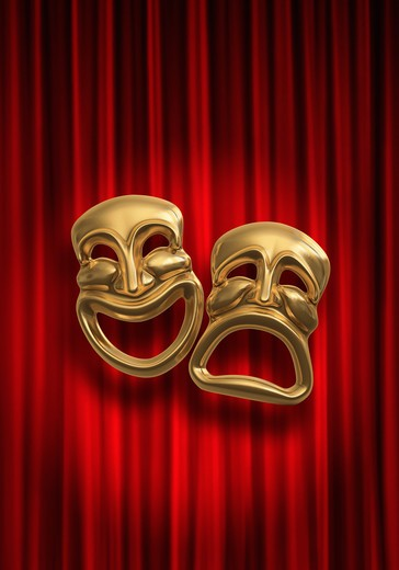 Classical comedy-tragedy theater masks against a red theatre curtain : Stock Photo