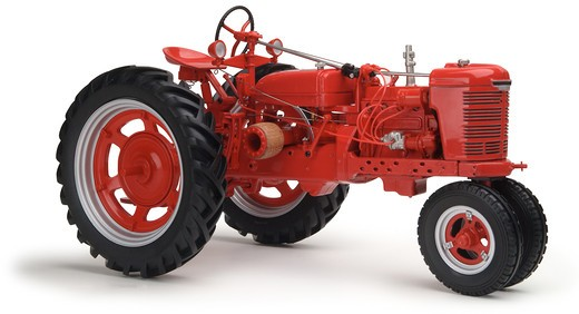 red Farmall tractor on white background shot at eye level : Stock Photo