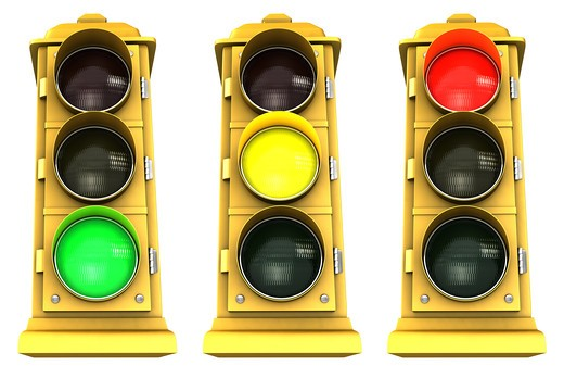 Three vintage downtown traffic light on white background showing Green, Yellow & Red. : Stock Photo