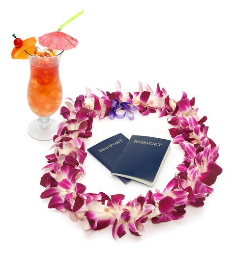 Stock Photo: 4193R-1734 Polynesian/Hawaiian lei shot on white with two passports and a tropical drink
