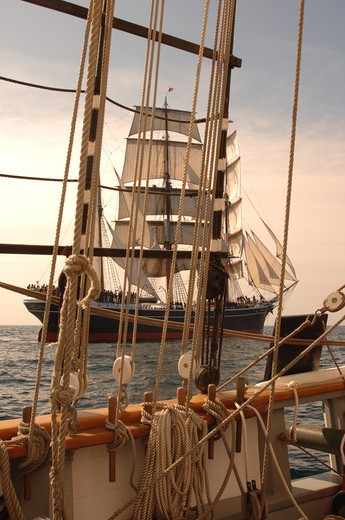 Vintage windjammer seen through the rigging of another vintage wooden ship : Stock Photo