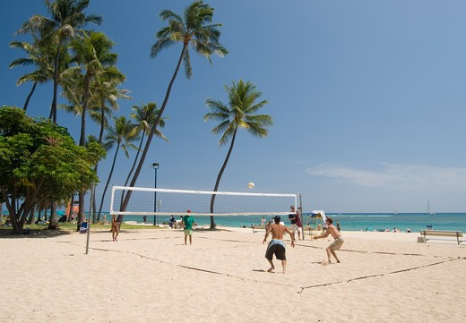 Stock Photo: 4193R-1803 People playing volleyball on a beach in Hawaii