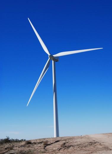 Stock Photo: 4193R-1864 A giant wind turbine against the deep blue sky