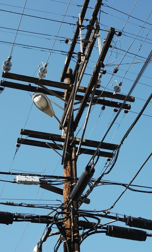 Stock Photo: 4193R-1871 telephone pole with electrical, telephone, communication and lighting wiring