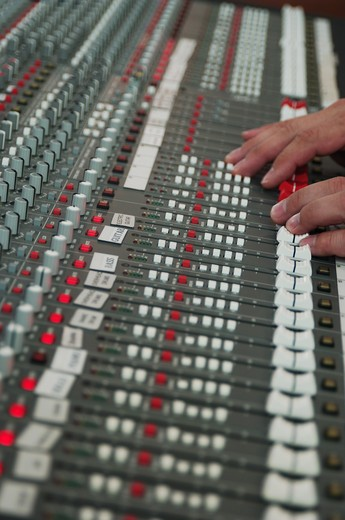 audio mixing board with hands : Stock Photo