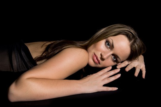 Medium shot of a beautiful female model on black : Stock Photo